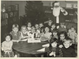 Santa Claus and children at the Free Public Library and Cultural Center of Bayonne